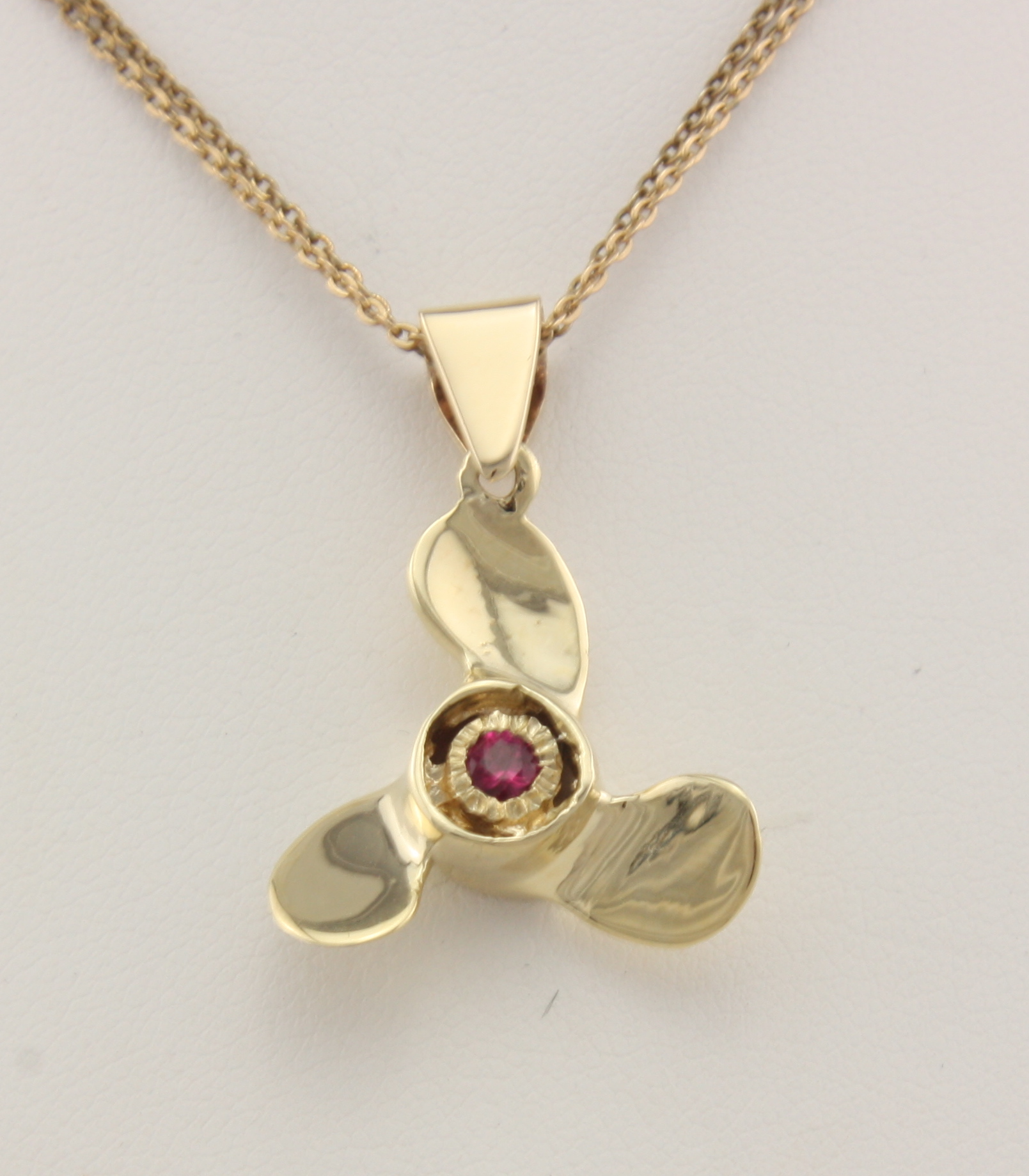 Large propeller with 1 4 ct ruby 14karat neptune for Jewelry stores in ct