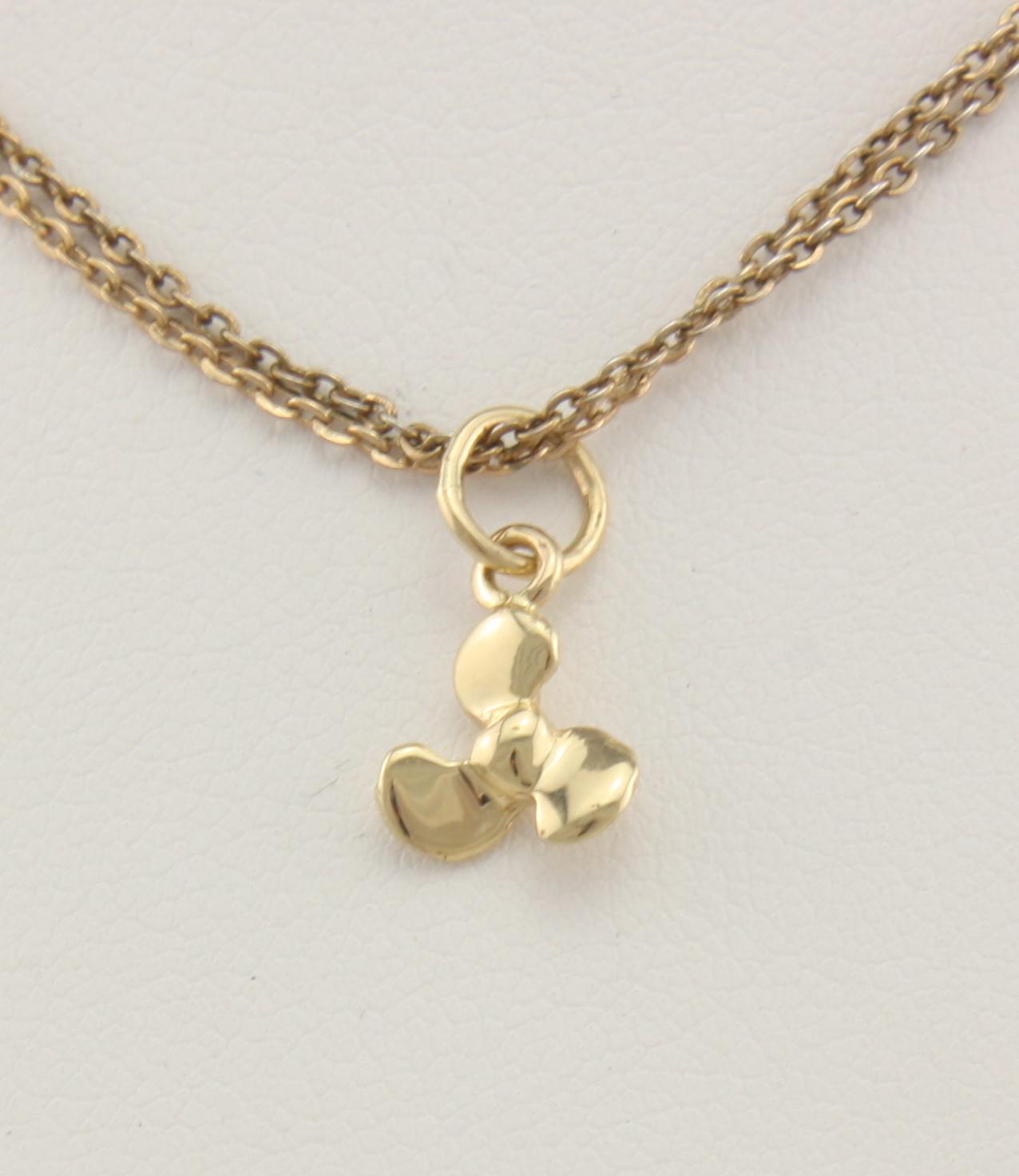 Tiny propeller 14karat neptune designs custom for Key west jewelry stores